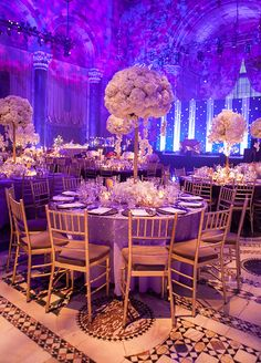 The reception space was transformed into a purple dream. #WeddingCenterpieces #PurpleWedding