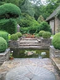 Gertrude Jekyll . munstead wood garden .  water feature and stone patio