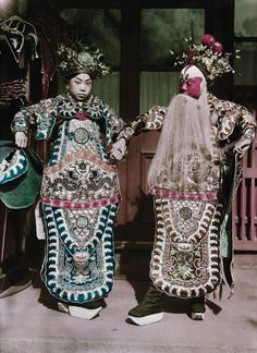 Actors don ancient court dress in a photo from a 1934 issue of National Geographic about China's coastal cities.