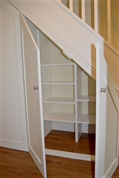 18 Useful Designs for Your Free Under Stair Storage #Under #Stair #Storage #DIY #DeadSpace #Staircase #Closets #Basement Take advantage of unused space under the basement stairs with these inexpensive (and DIY!) storage shelves. #StorageShelves