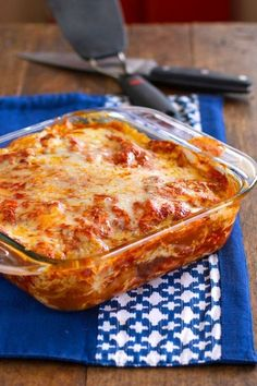 Stacked enchilada casserole in a clear baking dish.