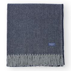 An elegant Merino wool throw in a timeless blue color. Made in the U.S.A. by a company with a long legacy of craftsmanship. This essential wool throw with the subtle zigzag texture adds simple elegance to any room.