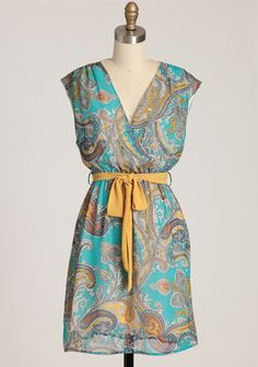 "Kaleidoscope Visions Paisley Dress 39.99 at shopruche.com. Turquoise, yellow, and gray hues come together in a unique paisley print that creates swirling movement on this silky dress. Perfected with a surplice neckline, a flattering elasticized waist, and an optional sash. Semi-sheer. Fully lined.100% Polyester, Made in USA, 35"" length from top of shoulders"