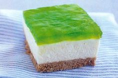 Lime Jello Cheesecake w/Pineapple This is a slight twist on the classic Hawaii jello cheesecake recipe - For St.  Patrick's Day, Instead of using the strawberry jello on the top, I decided to try using a lime jello with pineapple in it.  Do you remember when the school would serve green jello with pineapple in it?  One of my favorites next to the orange juice jello!  Happy Saint Patrick's Day!!