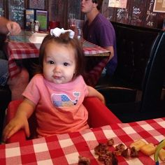 Dawn Robinson's sweet little girl enjoying some fries and a burger at Huey's Collierville. So cute.