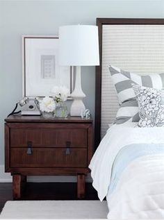 bedrooms - ICI Dulux - Universal Grey - brown gray blue white lamp wood nightstand cream upholstered wood headboard blue white bedding gray white striped stripe pillows gray blue walls bedroom