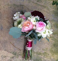 Jam jars, wedding flowers, autumnal colours, sliced log table flowers, Hessian & lace. All lovingly made by .....  www.weddingflowercompany.co.uk