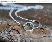Cyber Monday Etsy Sterling Silver Circle Necklace . Pendant Three Bubble Link Ring Jewelry Gift. $19.20, via Etsy.