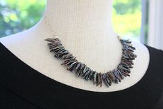 This one of a kind statement necklace is made up of beautiful peacock colored Biwa stick freshwater pearls. Chain and all components are sterling silver. The necklace measures 18.5 in length. This necklace would make a beautiful beach wedding necklace or summertime accessory. All