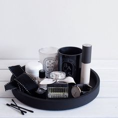 Vanity styling @acupofchic  Black circular bathroom tray. Back diptyque candle jar