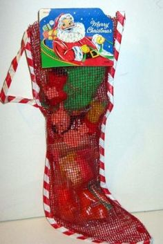Vintage 1960s Christmas Stocking filled with toys & candy.