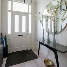 Narrow hallway entry ideas white hallway with contemporary console table and large round mirror narrow entry . House Entrance, Entrance Hall, Hallway Ideas Entrance Narrow, Doorway Ideas, Small Entrance, Entry Hallway, Hallway Furniture, Entryway Decor, Furniture Ideas