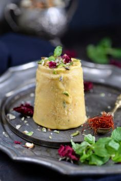 Kesar Mango Kulfi. Rich and creamy Indian dessert made with reduced milk and flavored with saffron and mangoes.