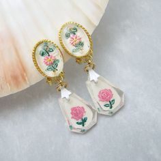 Hey, I found this really awesome Etsy listing at https://www.etsy.com/listing/229602596/vintage-rose-earring-pink-lucite-dangly
