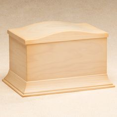 This elegantly crafted wood cremation urn is made in Spain from locally grown hardwoods. Features a satin-smooth clear finish adorning its lovely curves and corners.