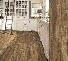 -LVT this is vinyl. Shaw Array luxury vinyl plank in style Aviator Plank, color Maverick Brown. Shaw Luxury Vinyl Plank, Luxury Vinyl Flooring, Luxury Vinyl Tile, Vinyl Plank Flooring, Vinyl Planks, Vinyl Wood, Cabin Kitchens, Home Upgrades, Living Room Designs