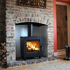 Wood Burning Stove - brick chimney with brick hearth Wood Burner Fireplace, Fireplace Hearth, Fireplace Design, Wood Stove Wall, Country Fireplace, Red Brick Fireplaces, Brick Hearth, Modern Fireplaces, Brick Wall