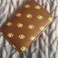 Dooney and Bourke ID holder Like new, great for traveling or just in your car! Accessories