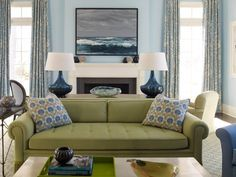 sage couch with blue and white accents