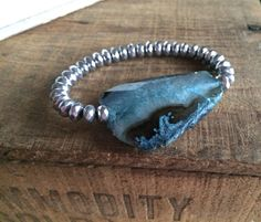 A personal favorite from my Etsy shop https://www.etsy.com/listing/164917552/teal-agate-slice-boho-bracelet-faceted