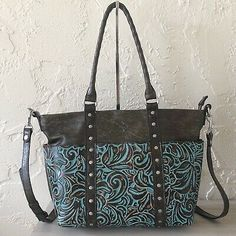 Tooled leather with handcrafted stitching and 2 slip pockets. Tooled Leather Purse, Leather Tooling, Leather Purses, Patricia Nash, Purse Strap, Diaper Bag, Brown Leather, Turquoise, Tote Bag