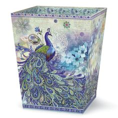 "Peacock Paisley Wastebasket - Our beautiful bathroom set features a lush peacock and floral design highlighted by an ethereal cascade of paisley plumes. Tissue Box Cover has silver foil detail. Both are pressed board. Wastebasket: 11"" high x 9"" sq. Tissue Box Cover: 5 1/2"" high x 4 3/4"" sq."