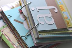 Idea: Saving greeting cards with binder rings (accommodates different sizes - unlike a binder . . .)