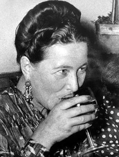 Simone de Beauvoir, visibily happy with her glass of wine. Café Procope, Paris, 1951. Photo: Simone de Beauvoir's Collection. - See more at: http://beauvoiriana.tumblr.com/page/2#sthash.s1Pi0bXQ.dpuf