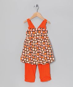 This sweet knit set is decorated with heart-shaped dots and bitty bows and pulls on easily thanks to elastic in back of the bubble-hemmed tunic. Plus the leggings are conveniently cropped to capri length, making them perfect for cross-seasonal wear.Includes tunic and capri leggings65% cotton / 35% polyesterMachine wash<...