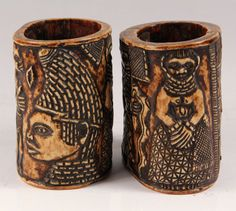 """AFRICAN IVORY CUFFS - Pair of Yoruba, Nigeria Relief Carved Ivory Cuffs, 18th c, from sections of elephant tusk, depicting tribal leaders, some holding snakes, each roughly 6 1/2"""" tall, 6 1/2"""" x 4 1/2"""", old copper repairs to interior."""