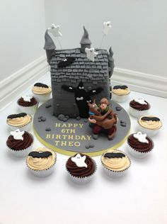 A Scooby Doo Haunted House Birthday Cake with matching cupcakes by Fancy Fondant