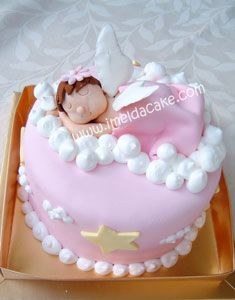 Sleeping Angel Cake: This sleeping angel cake consists of a single 9 tier topped with a gum paste angel. I wanted to make a cake for a baby girl that showed how angelic she