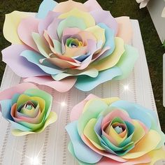 "3 sizes of my giant unicorn paper roses for sale large is 26"" wide £25 medium 12.5"" £15 small 9"" £8 plus delivery #unicorns #giantpaperflowers #unicorn #partyideas #kidspartys #girlsbirthday"