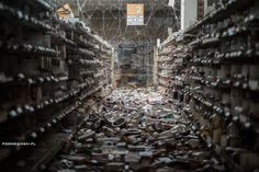 Massive spiderwebs cover the interior of a grocery store that was abandoned in the wake of the Fukushima disaster.