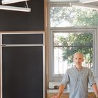 """Riffing on the Los Angeles phenomenon of people """"murdering out"""" their cars—that is, removing all the trim and blacking everything out—architect Barbara Bestor and craftsman Eric Lamers covered most surfaces in this Los Angeles kitchen with matte black laminate, including the fridge and the overhead cabinets. Photo by Ye Rin Mok."""