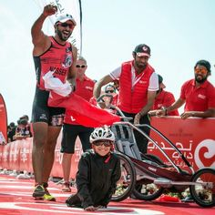 Sheikh Nasser Bin Hamad Al Khalifa of Bahrain and Ghanim, a 12-year-old disabled boy, who he pushed in a cart and carried with him while he competed in a triathlon, photo via his Instagram @nasser13hamad