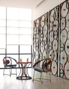 The Bicycle Screen, made of discarded bicycle parts, has three panels that are hinged together, allowing for many configurations.
