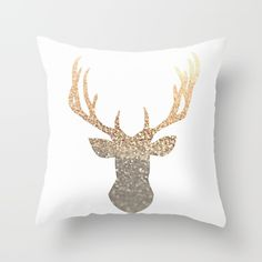 Bestseller pillow in 2016 - perfect gold stag / antler  pillow for every room! Too cute! I like that this is not glitter gold - you can so easy wash and dry! GOLD DEER  Throw Pillow $20 by Monika Strigel.
