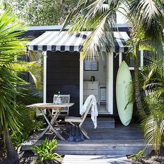 Black and white paint, awning and palms. Very beachy