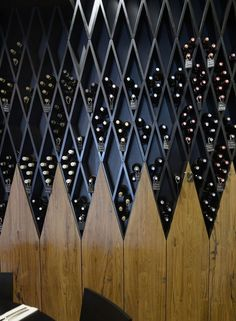 A Wine Wall Made Of Diamond Shaped Shelves - Zeutch #restaurantdesign #Diamondsshapes #WineCellar
