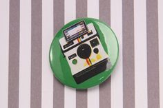 Polaroid card with Badge. This cool card features a handmade 'polaroid' badge on a grey stripe card. Comes with a matching white luxury envelope.