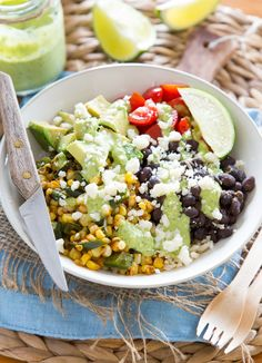 For this burrito-inspired dinner bowl, I ditched the tortilla and layered everything into a big bowl. Tender brown rice, garlicky black beans, spicy roasted corn, fresh cherry tomatoes, avocado chunks, and the most delicious cilantro-lime dressing drizzled over the top — each bite is perfect!
