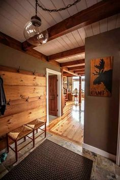 Mudroom to kitchen attached garage wall color gray warm greige  A post and beam entry to a smaller mountain lodge style post and beam barn home.