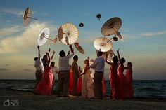 Destination beach wedding at Dreams Riviera Cancun, a little fun with the bridal party and parasols.  Mexico beach wedding photographers Del Sol Photography