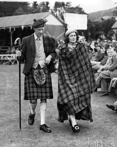 +~+~ Vintage Photograph ~+~+   Captain Alwyne Farqharson of Invergate and his wife arriving at the Braemar Highland Gathering in Aberdeenshire.  9 September 1952
