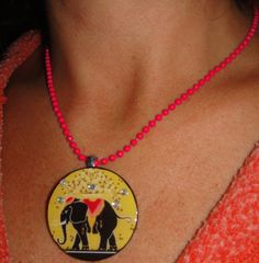 Vintage French Label Elephant Art Poster Recycled Poker Chip Pendant Necklace with Swarovski Crystal Bling. $19.95, via Etsy.