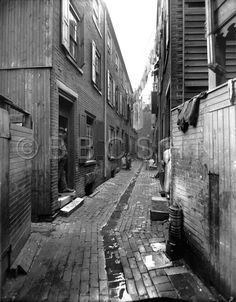 Crooked Alley with Hanging Clothes, circa 1910. Starr Centre Association of Philadelphia. Image courtesy of the Barbara Bates Center for the Study of the History of Nursing.
