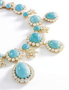 Turquoise and diamond demi-parure, 'Liberté', Van Cleef & Arpels, 1970s. Comprising: a necklace designed as a graduated row of cushion-shaped turquoise within brilliant-cut diamond borders, the front supporting a fringe of cabochon turquoise drops.