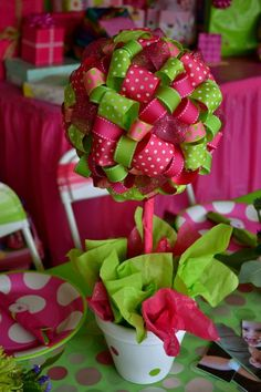 cute centerpiece, this be cute with pink and purples for a girl and blues for a boy