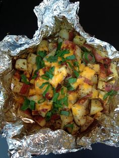 easy foil packet cheesy red potatoes, made on the grill